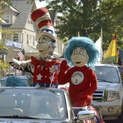 A character portraying the Cat in the Hat parades with Thing 2 on Tuesday after he declared he is running for president, outside the childhood home of their creator Theodor Geisel, better known as Dr. Seuss, on Fairfield Street in Springfield, Mass.