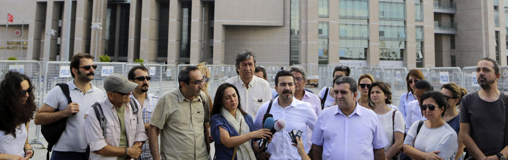Journalists gather Wednesday to support a colleague who was detained Tuesday in Istanbul. The move against media outlets escalated a campaign against journalists in a country that was once hailed as a model of democracy in the region.