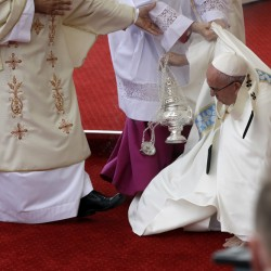 Pope Francis is helped by Vatican Master of Ceremonies, Mons. Guido Marini as he stumbles on the altar as he celebrates a mass in Czestochowa, Poland.