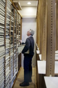 New Bedford Whaling Museum senior maritime historian Michael Dyer combs through the racks of whaling vessel log books in New Bedford, Mass.