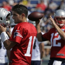 Quarterback Jimmy Garoppolo, left, is sharing reps with Tom Brady, right, on the first team as training camp begins. Garoppolo will get his first regular-season start at Arizona. Steven Senne/Associated Press