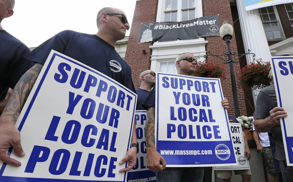 Police officers and their supporters picket Thursday outside Somerville, Mass., City Hall, where Mayor Joe Curtatone maintains it is not anti-law enforcement.
