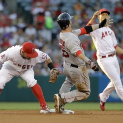 Boston's Dustin Pedroia is caught stealing second base by Los Angeles' Johnny Giavotella in the first inning Thursday night in Anaheim, Calif.