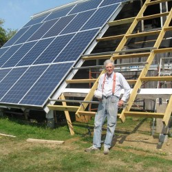 The humble Farmer adds eight panels to the solar array at his St. George home. They provide all the electricity he and his wife need, with enough left over to power an electric car.