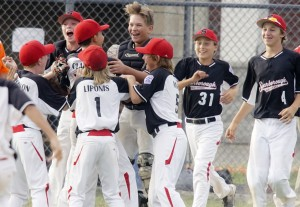 Scarborough pitcher Sam Clark is mobbed by his teammates Friday after completing a four-inning one-hitter in a 14-0 victory against Biddeford that gave his team the Little League state championship. Scarborough advanced to the New England regionals in Bristol, Connecticut.