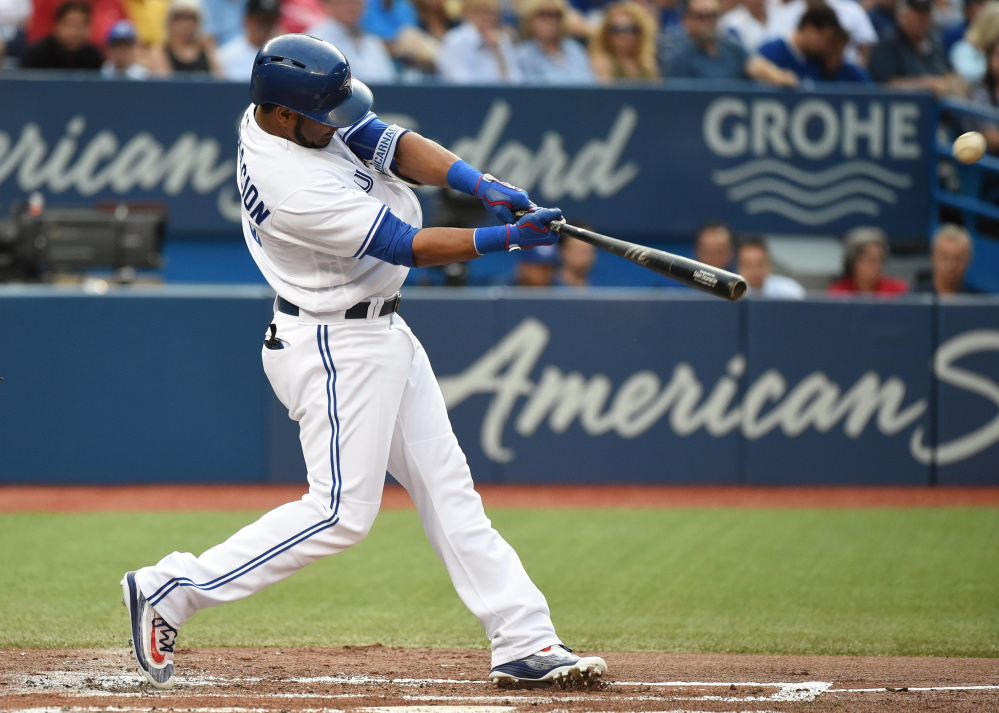 Toronto's Edwin Encarnacion homers during the Blue Jays' three-home run first inning Friday night against the Orioles. Toronto won 6-5 at home.