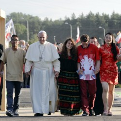 Pope Francis, accompanied by youths, passes through the Door of Mercy ahead of a prayer vigil on the occasion of World Youth Day, in Campus Misericordiae in Brzegi, near Krakow, Poland, on Saturday.