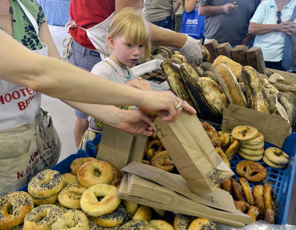 Little Francis DeGeer gets a rise from the many baked goods on display Saturday at the Maine Artisan Bread Fair in Skowhegan, where scores of vendors attracted some 2,500 people from Maine and elsewhere.