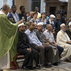 Muslims attend a Mass in Rome's Saint Mary in Trastevere church, Italy, Sunday, July 31, 2016. Imams and practicing Muslims attended Mass across Italy, from Palermo in the south to Milan in the north, in a sign of solidarity after the France church attack in which an elderly priest was slain. (via AP)