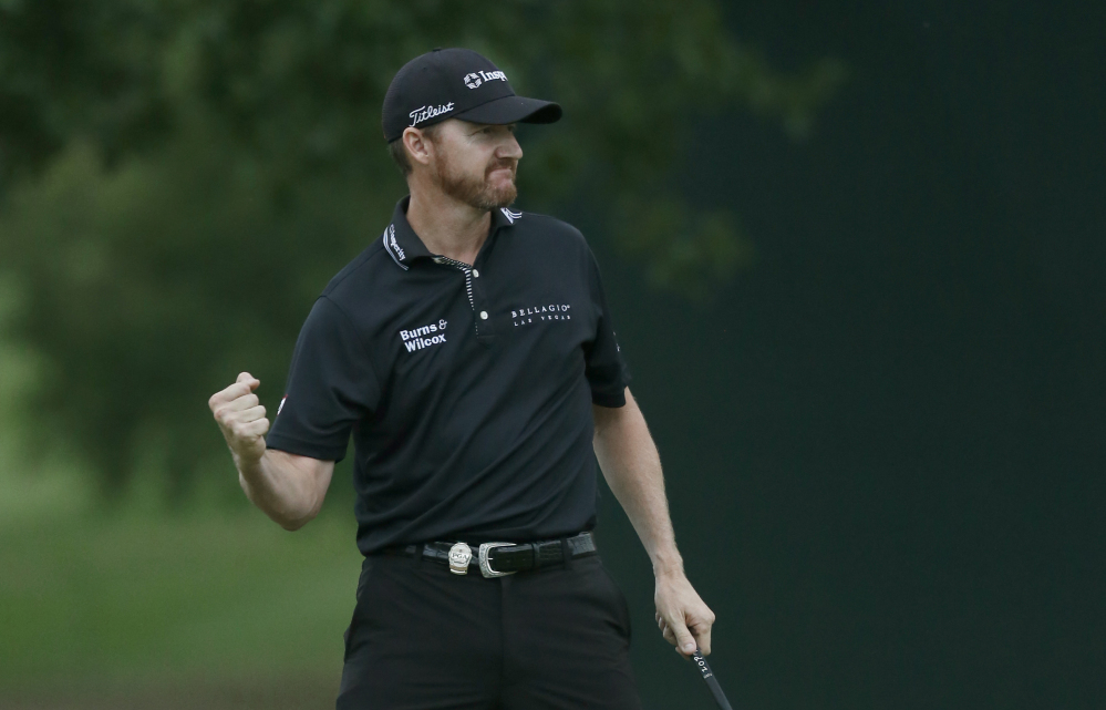 Jimmy Walker celebrates after making his par putt on the final hole Sunday to secure the PGA Championship. Walker finished at 14-under 266 – one shot better than defending champion Jason Day.