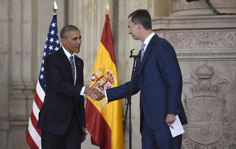 President Obama shakes hands with Spain's King Felipe VI at the Palacio Real de Madrid in Madrid, Spain on Sunday.