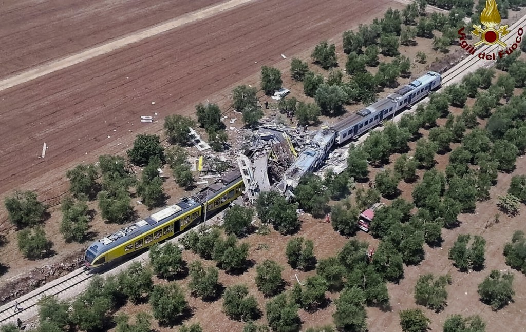 This aerial handout photo shows what is left of two commuters trains after their head-on collision in the southern region of Puglia, Tuesday, July 12, 2016. (Italian Firefighter Press Office via AP)