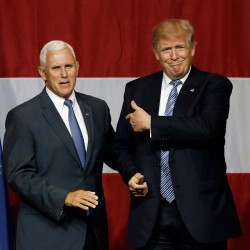 Indiana Gov. Mike Pence joins Republican presidential candidate Donald Trump at a rally in Westfield, Indiana, Tuesday.