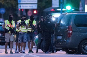 Special police forces prepare to search a neighboring shopping center outside the Olympia mall in Munich, Germany, on Friday.