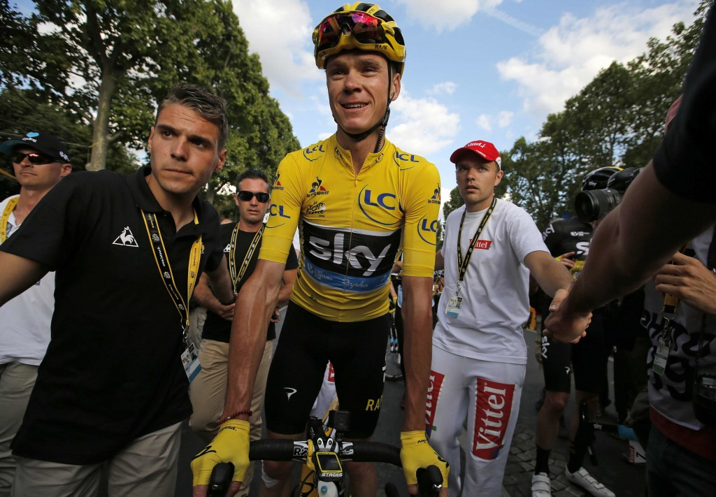 Britain's Chris Froome, the 2016 Tour de France champion, wears the overall leader's yellow jersey after finishing the 21st stage of the Tour de France in Paris on Sunday. Associated Press/Christophe Ena