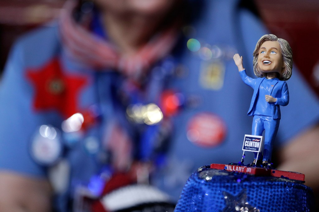 A delegate wears a hat with a bobble-head doll of Democratic Presidential candidate Hillary Clinton.