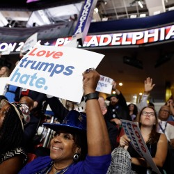 Georgia delegate Pat Pullar holds up a sign as the DNC gets underway.