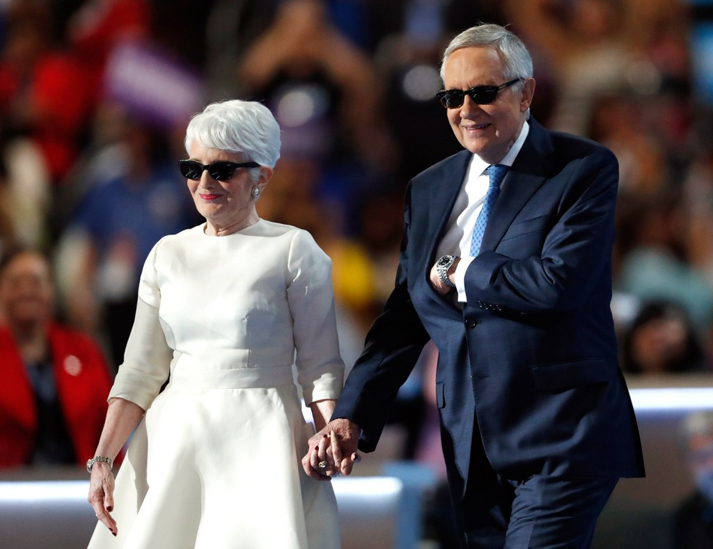Senate Minority Leader Harry Reid of Nevada is escorted to the podium by his wife, Landra, before speaking during the third day of the Democratic National Convention in Philadelphia on Wednesday.