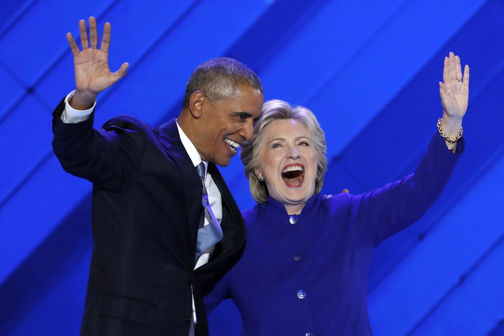 President Barack Obama and Democratic presidential nominee Hillary Clinton wave to delegates after President Obama's speech during the third day of the Democratic National Convention in Philadelphia on Wednesday.