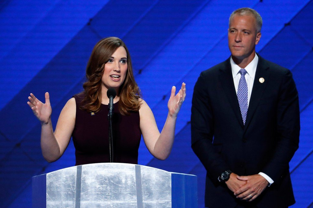 LGBT rights activist Sarah McBride speaks as Rep. Sean Patrick Maloney, D-NY, co-chair of the Congressional LGBT Equality Caucus, stands at right, during the final day of the Democratic National Convention in Philadelphia on Thursday.