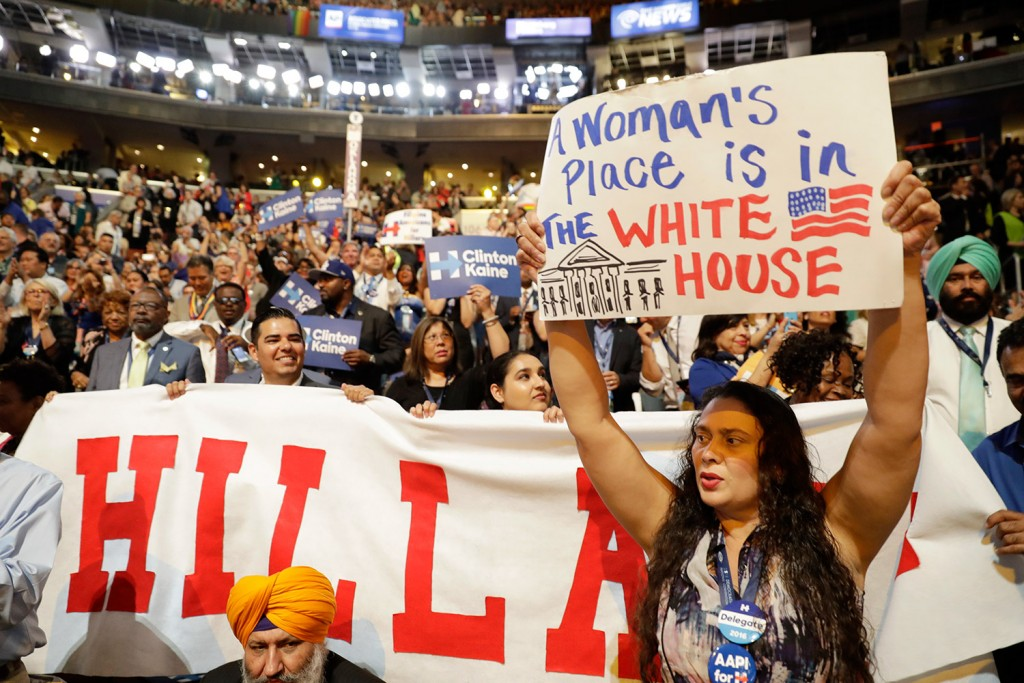 California delegates hold up signs as they cheer for Democratic presidential nominee Hillary Clinton during the final day of the Democratic National Convention in Philadelphia on Thursday.