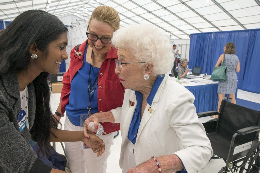 Jerry Emmett, 102, of Prescott, Ariz., talks with Sruthi Palaniappan, an 18-year-old Iowa delegate, at the Democratic National Convention in Philadelphia on Wednesday. Emmett was born before women gained the right to vote in America, so it's fitting she announced that the Arizona delegation was casting 51 of its 85 votes for Hillary Clinton for president on Tuesday.