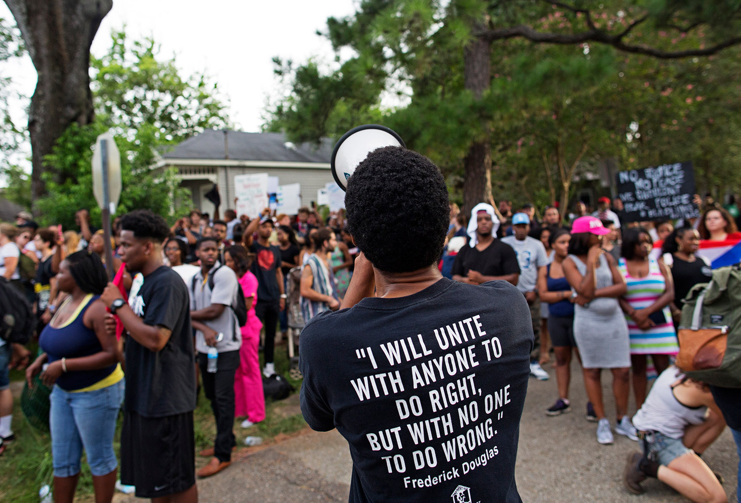 Protesters demonstrate in a residential neighborhood in Baton Rouge, La. on Sunday. After an organized protest in downtown Baton Rouge protesters wandered into residential neighborhoods and toward a major highway that caused the police to respond by arresting protesters that refused to disperse.