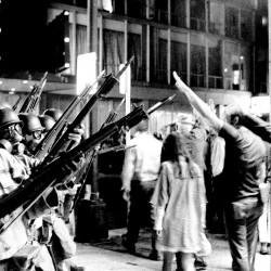 A group of protesters raise their arms in the air and taunt bayonet-armed National Guardsmen near Michigan Avenue in Chicago on Aug. 28, 1968. Police and National Guardsmen battled the demonstrators during the evening. Anti-war street violence contributed greatly to the election of Richard Nixon as president, says columnist M.D. Harmon.