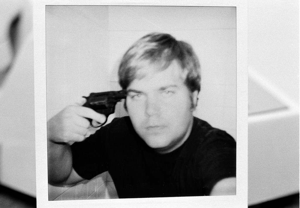 John W. Hinckley Jr., who attempted to assassinate President Ronald Reagan in March 1981, holds a pistol to his head in this self-portrait obtained from court records in Oct. 1982.  The FBI released the polaroid image, which was part of the evidence used in Hicnkley's trial. A judge ruled that Hinckley will be released from a federal psychiatric facility after more than 35 years.