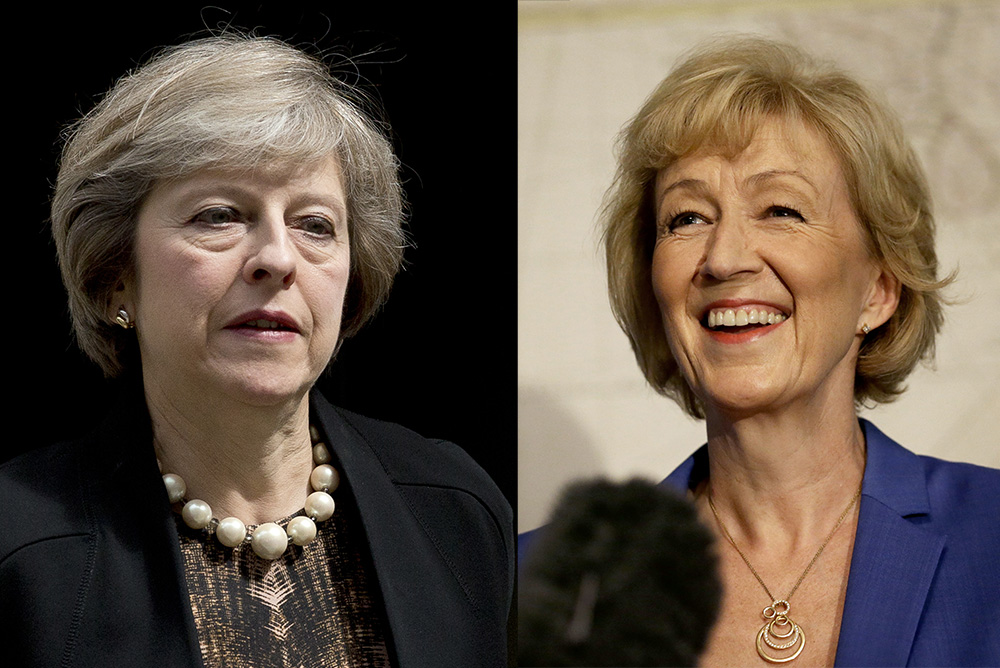 Conservative Party Members of Parliament, Home Secretary Theresa May, left, and Energy Secretary Andrea Leadsom. Leadsom says she didn't have sufficient support within the party to remain in the race for the leadership post. Associated Press