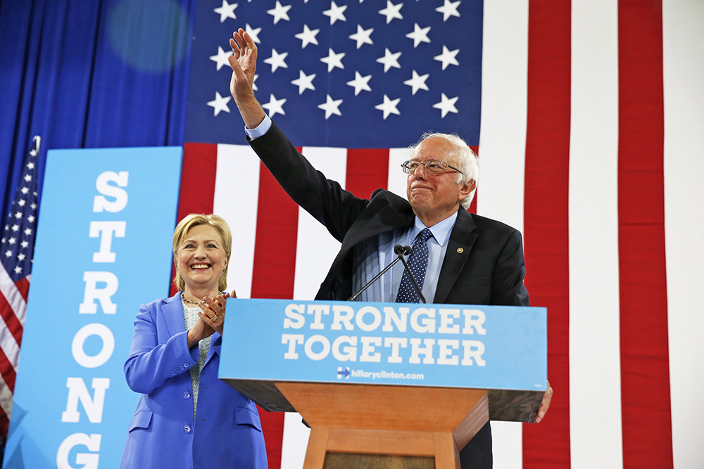 Sen. Bernie Sanders and Democratic presidential nominee Hillary Clinton appear at a rally in Portsmouth, N.H., in July. Andrew Harnik/Associated Press