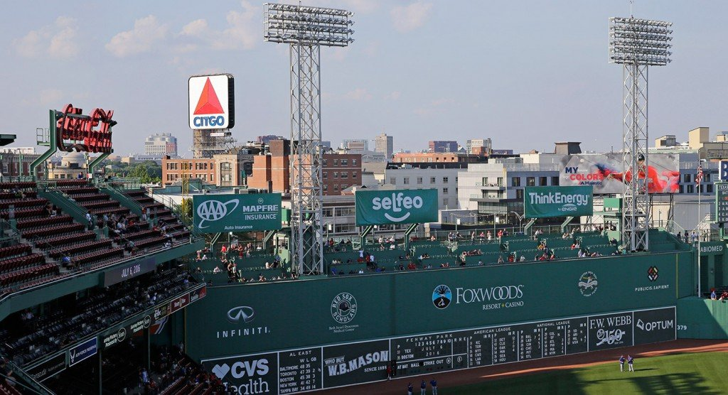 The iconic Citgo sign looms in the background of Fenway Park in Boston. The Boston Landmarks Commission meets Tuesday to decide whether to launch a study to determine if the sign qualifies for preservation as an historic landmark.