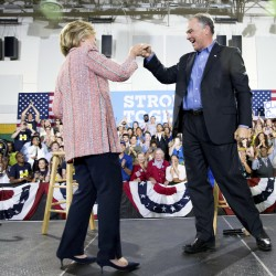 Democratic presidential candidate Hillary Clinton fist bumps Sen. Tim Kaine, D-Va., after speaking at a rally in Annandale, Va., last Thursday. Andrew Harnik/Associated Press