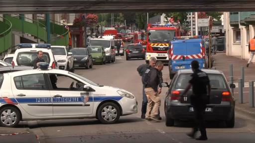 Police speak to a driver as they close a road during a hostage situation in Rouen, in Normandy, France, on Tuesday. (BFM screen image via )AP