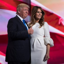 """Donald Trump gives a thumbs-up after his wife, Melania, spoke during the Republican National Convention on Monday night in Cleveland. She told the crowd, """"I have been aware of his love for this country since we first met."""" Associated Press/Evan Vucci"""