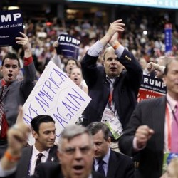 Delegates cheer during the second day of the Republican National Convention Tuesday. Gov. Paul LePage made a forceful case that as a Donald Trump supporter and governor he should be part of the delegation. But he twice told audiences in July he would stay at home and focus on his work in Maine. Matt Rourke/Associated Press
