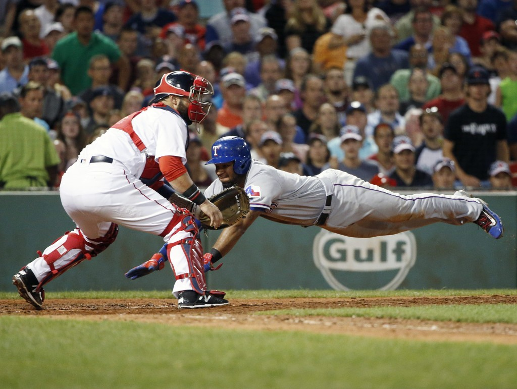 Texas' Elvis Andrus scores on a double as Boston's Sandy Leon waits for the throw during the sixth inning Tuesday.    Associated Press/Michael Dwyer