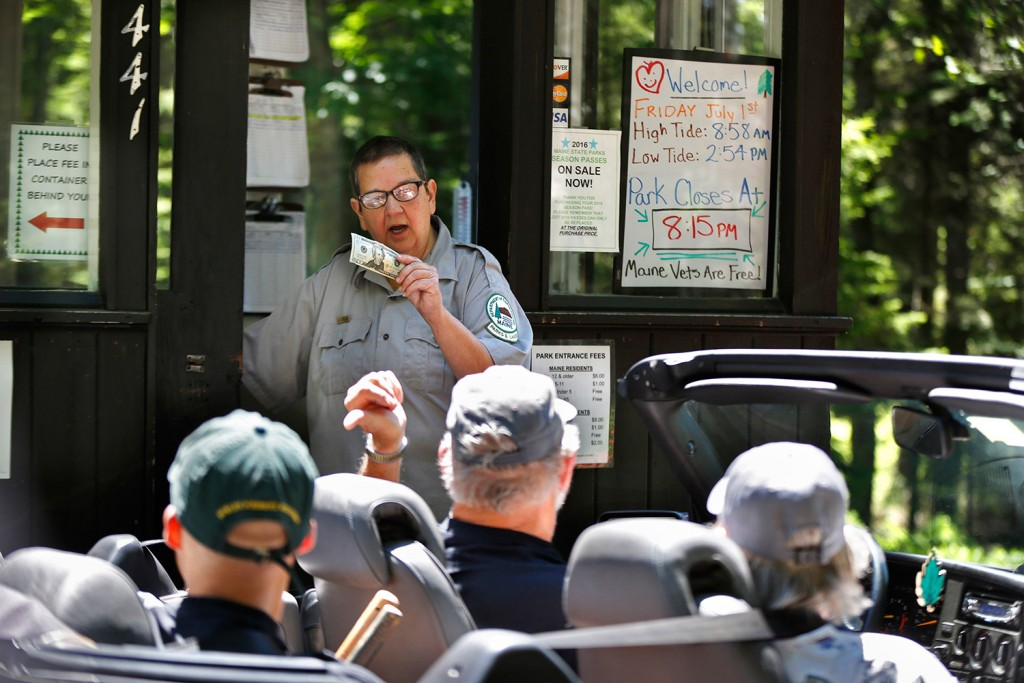 Sarah Crosby collects entrance fees Friday at Reid State Park in Georgetown, where she has worked since 1972. Associated Press/Robert F. Bukaty