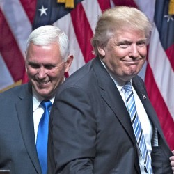 Republican presidential candidate Donald Trump introduces Gov. Mike Pence, R-Ind., during a campaign event Saturday in New York. Evan Vucci/Associated Press