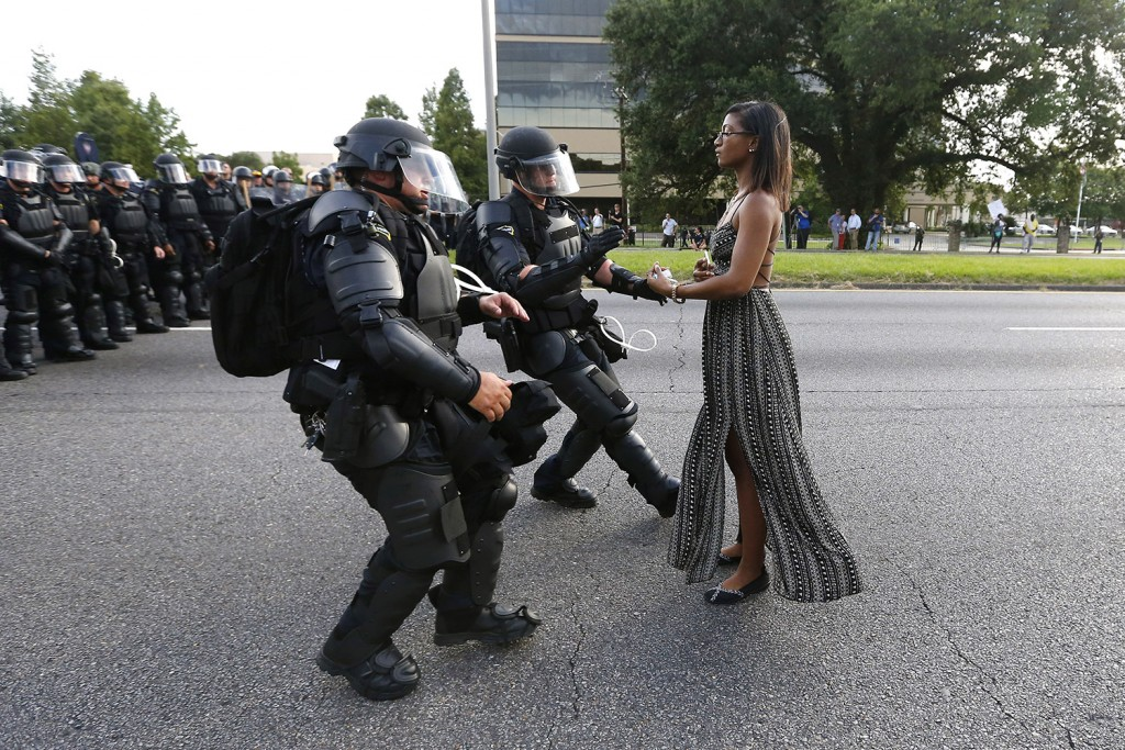 A demonstrator protesting the shooting death of Alton Sterling is detained by law enforcement near the headquarters of the Baton Rouge Police Department in Baton Rouge, Louisiana, on Saturday.