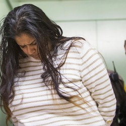 FILE - In this March 30, 2015 file photo, Purvi Patel is taken into custody at the St. Joseph County Courthouse in South Bend, Ind., after being sentenced to 20 years in prison for feticide and neglect of a dependent. On Friday, July 22, 2016, the Indiana Court of Appeals overturned the conviction of Patel, who was found guilty of killing the premature infant she delivered after ingesting abortion-inducing drugs. However, the court upheld a lower-level felony neglect of a dependent conviction. (Robert Franklin/South Bend Tribune via AP, File)