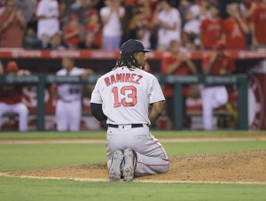 Boston Red Sox first baseman Hanley Ramirez kneels on the mound in the 9th inning after his bad throw to home plate allowed the Angels to score 2 runs and walk off with a 2-1 win against the Sox Thursday night in Anaheim, Calif. Jae C. Hong/Associated Press