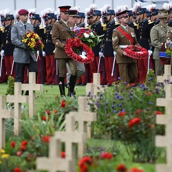 Soldiers leave sprays of flowers during a ceremony commemorating the centenary of the deadliest battle of WWI,  at the Thiepval WWI cemetery, northern France.