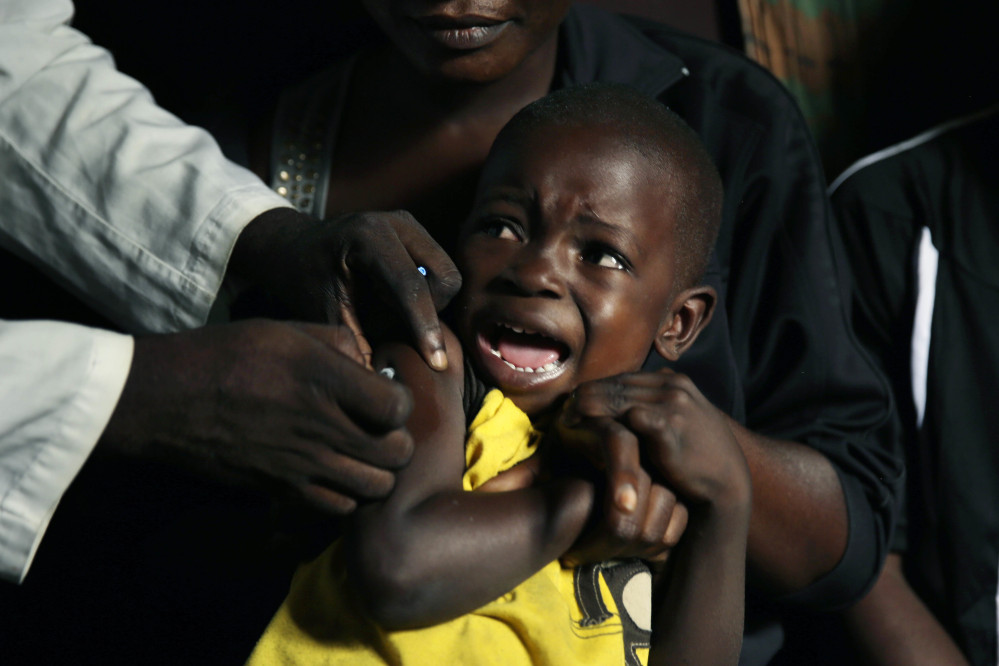 A boy reacts as he receives a yellow fever vaccine injection in the Kisenso district of Kinshasa, Congo, on July 21. Associated Press/Jerome Delay