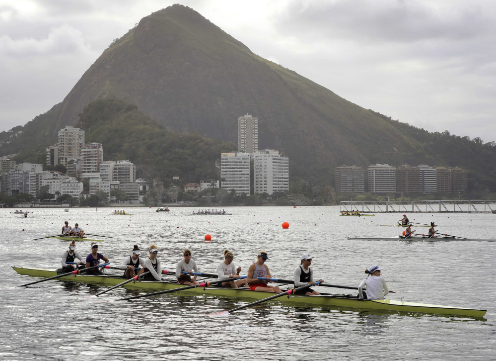 The women's eight rowing team from the United States, including Eleanor Logan of Boothbay Harbor, third from the right, warms up during team practices before the Summer Olympics in Rio de Janeiro.