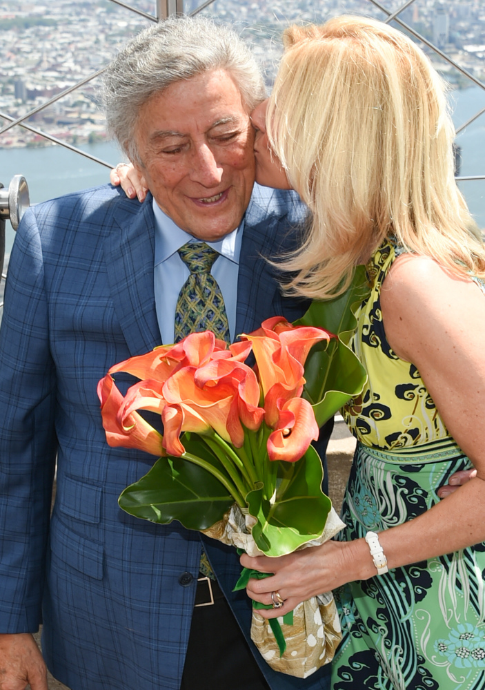 Tony Bennett gets a kiss from his wife, Susan Crow, at the Empire State Building.