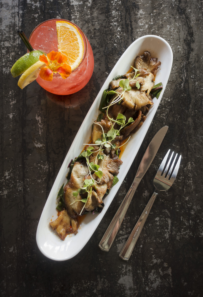 An order of North Spore Mushroom with Brisket Vinaigrette, along with a colorful sangria, is ready to be consumed at Local 188 restaurant on Congress Street in Portland.