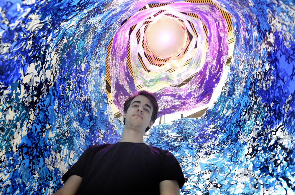 "Carter Shappy inside his cylindrical ""Colorcosm"" at Bigelow Laboratory for Ocean Sciences in East Boothbay. The 20-foot-high print emulates an enclosure used by scientists in underwater research."
