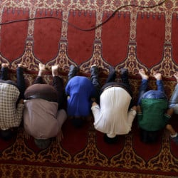 Muslim migrants who live in Greece pray at the Greek-Arab Cultural Center, a Muslim prayer site, in Athens, Thursday, Aug. 4, 2016. Lawmakers in Greece have approved construction of a state-funded mosque near central Athens, a proposal that triggered dissent within the country's coalition government amid a heated public debate on how manage the migrant crisis. (AP Photo/Thanassis Stavrakis)
