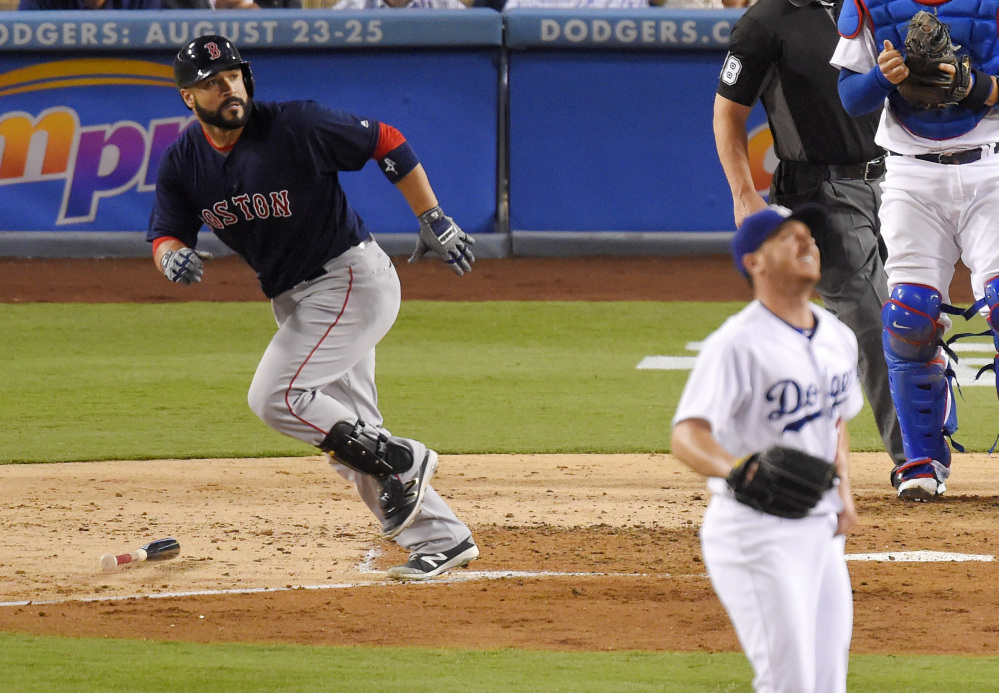 Red Sox catcher Sandy Leon watches his two-run homer leave the park in the fourth inning Friday night against the Los Angeles Dodgers. Leon drove in four runs to spark the Red Sox to a 9-0 win.